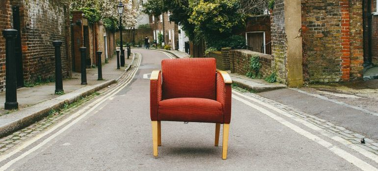 An old chair sitting on the street