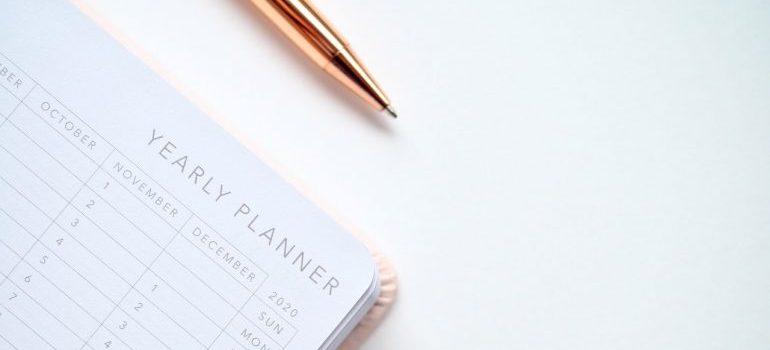 A calendar and a pen.
