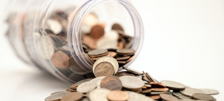 Coins spilling from the jar