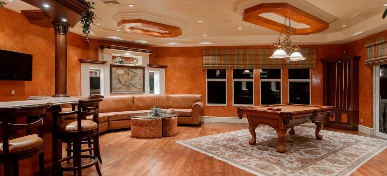 Dimly lit living room with a rustic pool table