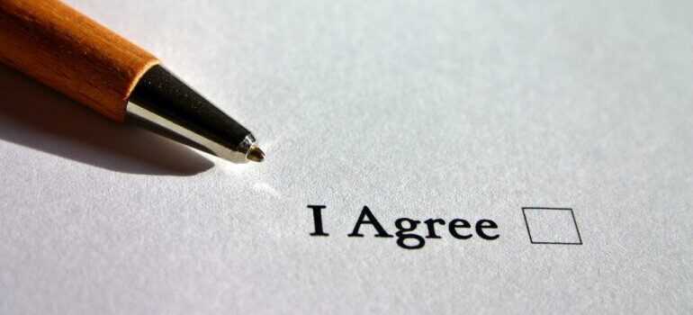 A pen and a piece of paper titled 'I agree'.