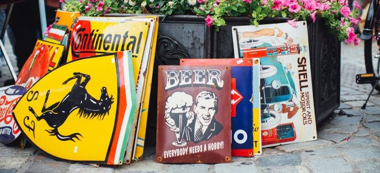 assorted posters and signs at a yard sale