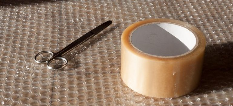 scissors and tape on bubble wrap
