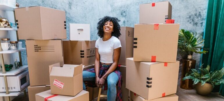 Woman smiling because she managed to find find reliable interstate movers