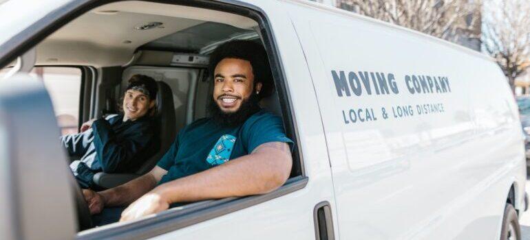 Two smiling man sitting in a van
